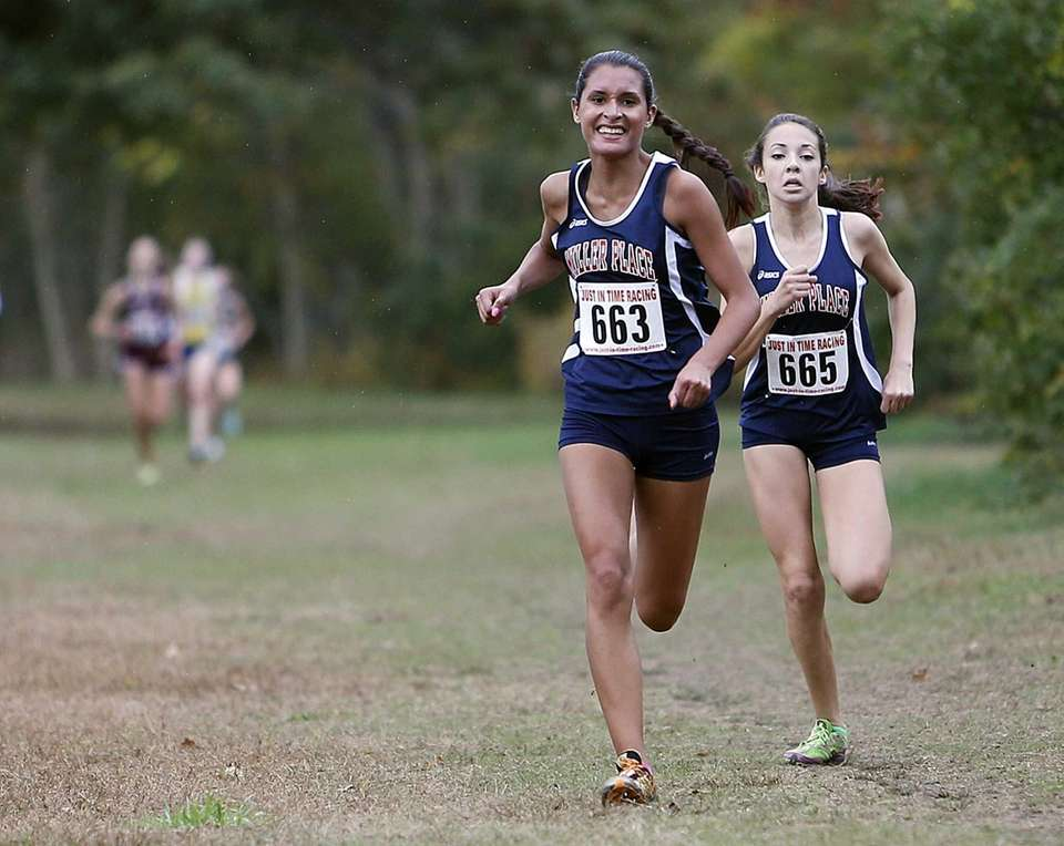 Miller Place teammates Talia Guevara (663) and Laura