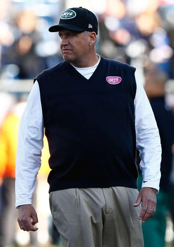 Rex Ryan watches his team warm up before
