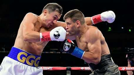 Gennady Golovkin, left, punches Sergiy Derevyanchenko during their