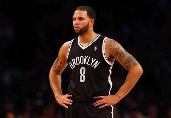 Deron Williams looks on during a preseason game