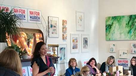 Actress Ashley Judd speaks at a coffee shop