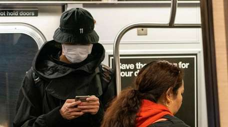 A subway rider wears a mask on Tuesday.