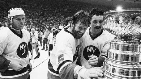 Islanders captain Denis Potvin, No. 5, reaches out