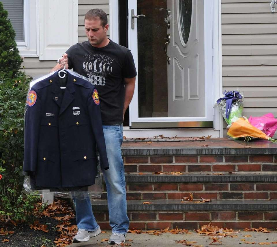 Nassau County Police Officer Joseph LoBello removes a