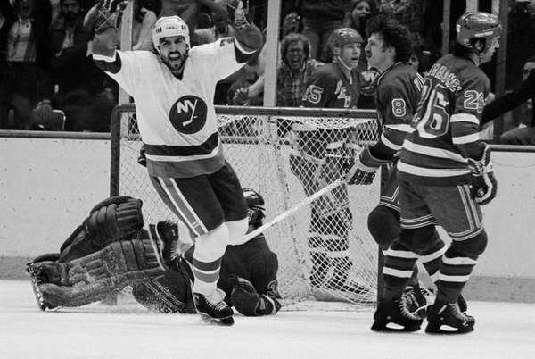 John Tonelli of the Islanders, left, reacts after