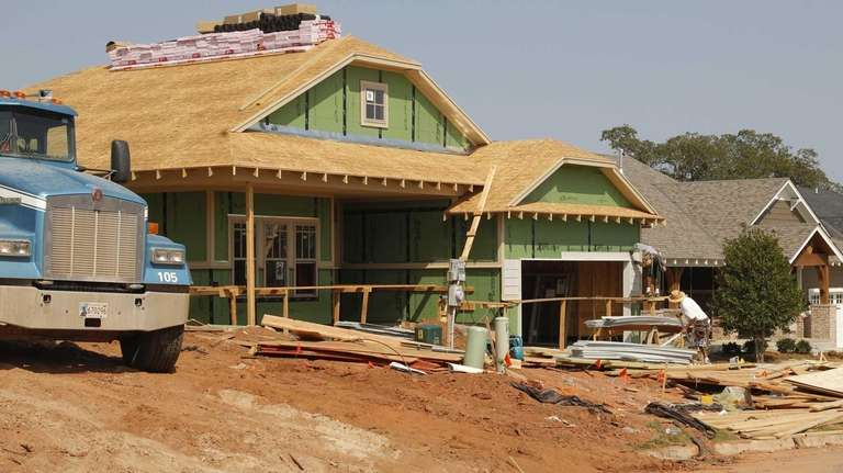 A new home goes up in Edmond, Okla.,