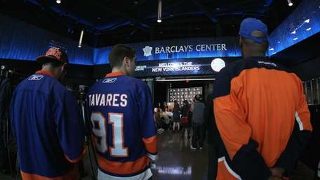 Fans congregate as New York Islanders owner Charles