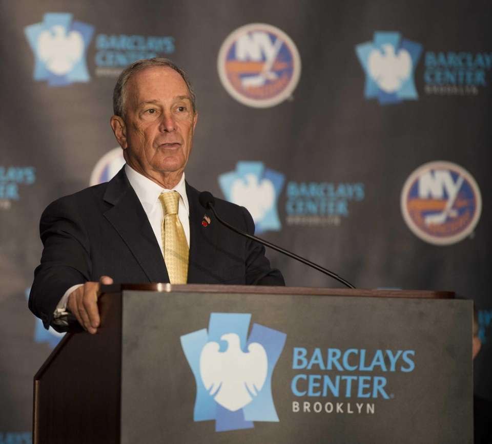 New York City mayor Michael Bloomberg talks to