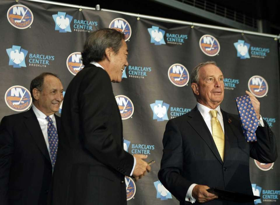 New York Mayor Michael Bloomberg, right, shows off