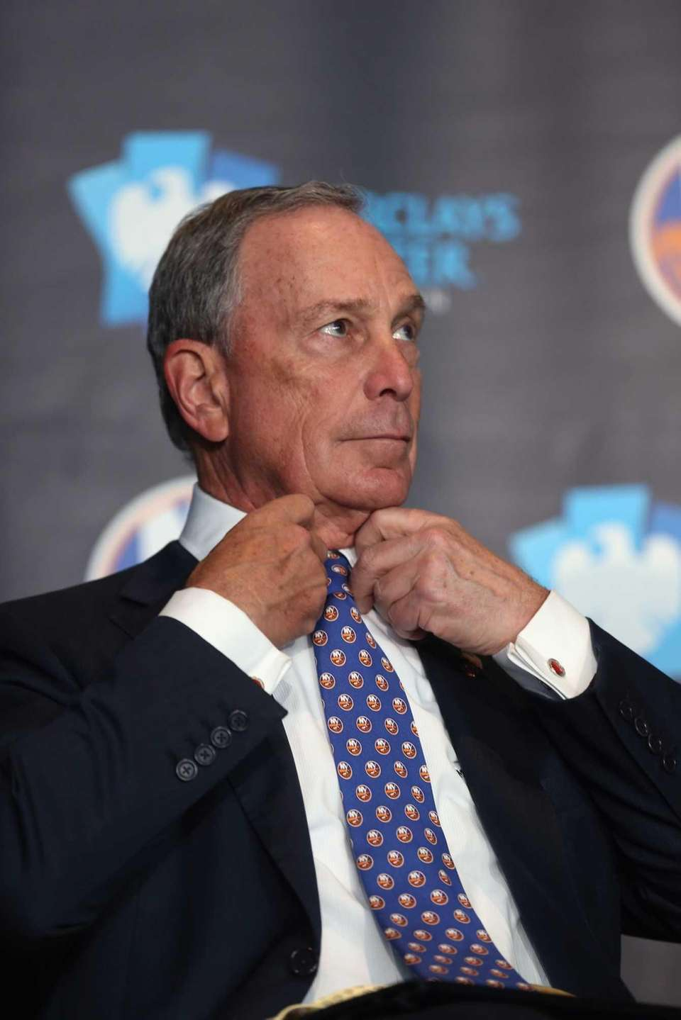New York Mayor Michael Bloomberg adjusts his new