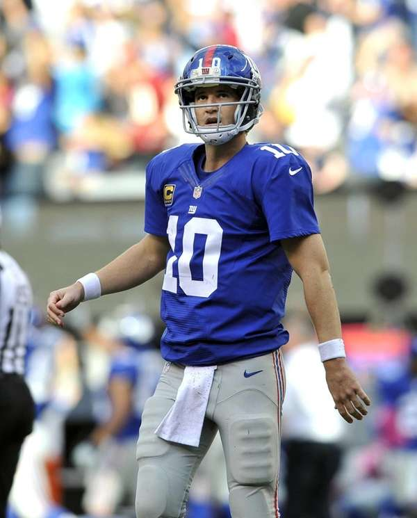 Eli Manning watches the video board to see