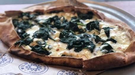 A spinach and feta pide, or flatbread, at