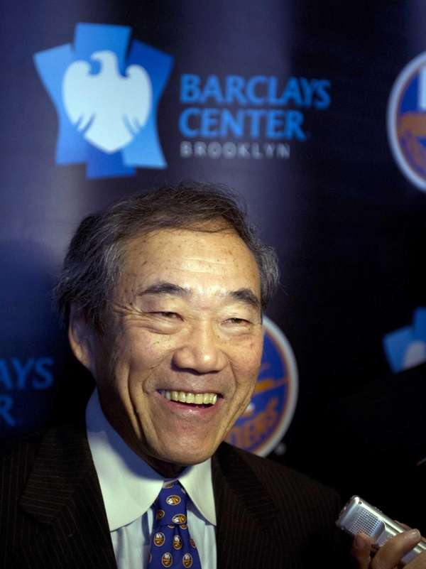 Charles Wang talks to the media during a