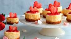 Individual cheesecakes are cooked in a muffin pan