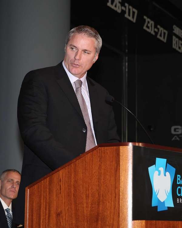 Islanders general manager Garth Snow speaks with the