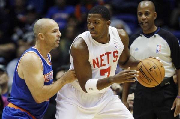 Jason Kidd of the Knicks, left, defends against