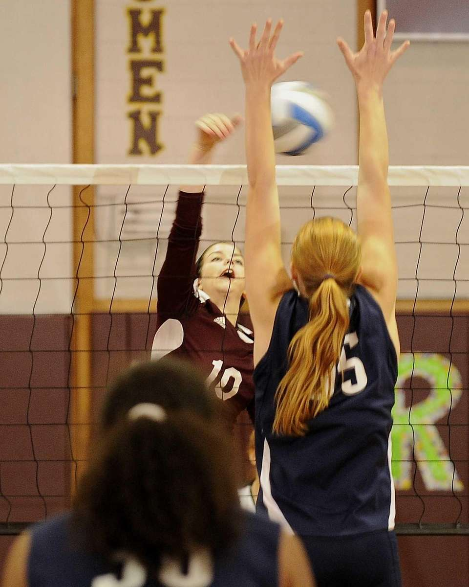 Kings Park's Amanda Gannon's shot is defended by