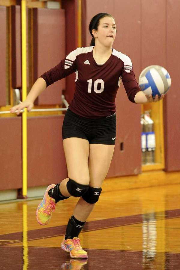 Kings Park's Amanda Gannon serves the ball against