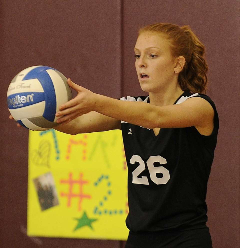 Kings Park's Tara Trapani lines up to serve