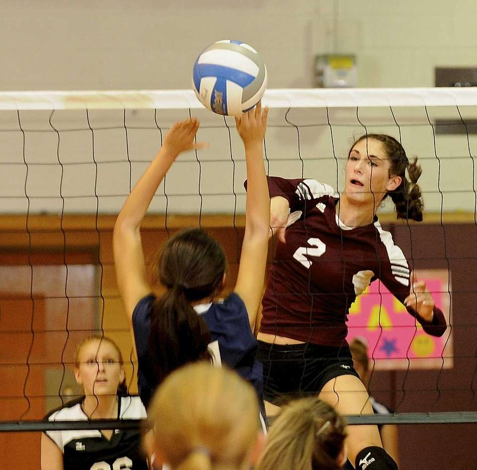 Kings Park's Joelle Goldstein spikes the ball past