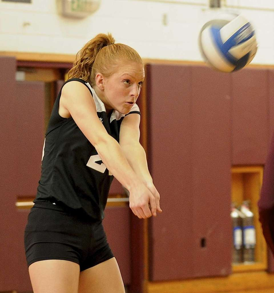 Kings Park's Tara Trapani digs the ball against