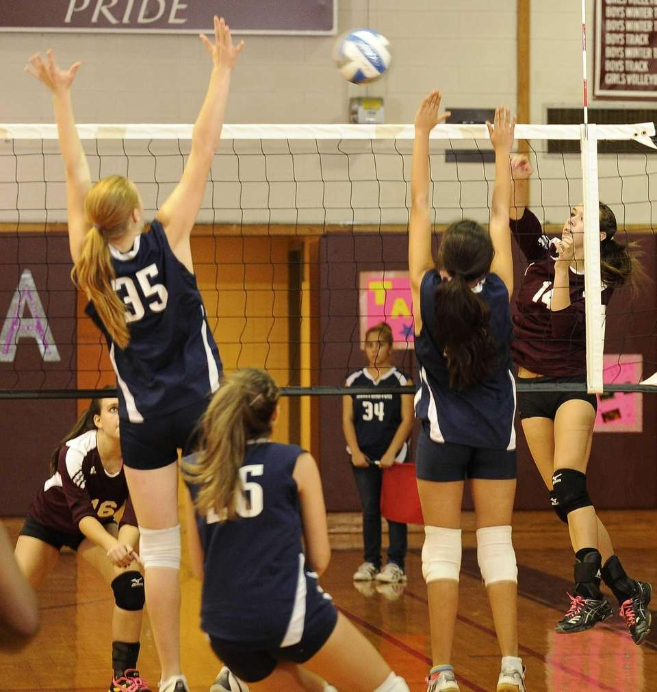 Kings Park's Michelle Sehested hits the ball between