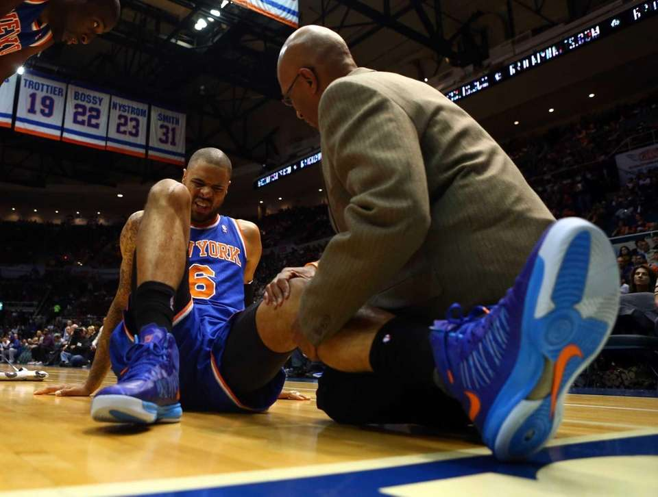 Tyson Chandler is tended to after suffering an