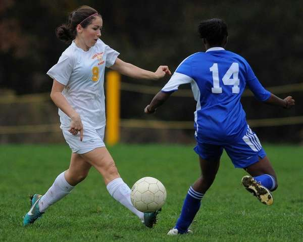 Sacred Heart's Reilly Lucas, left, gets pressured by