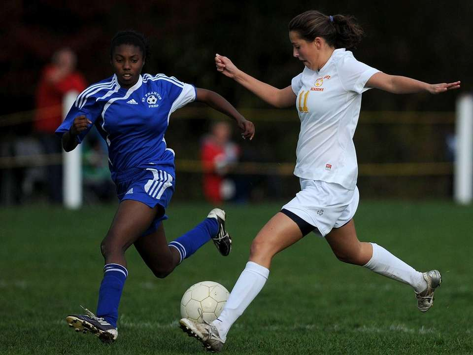 Sacred Heart's Danielle Wilson, right, looks to get
