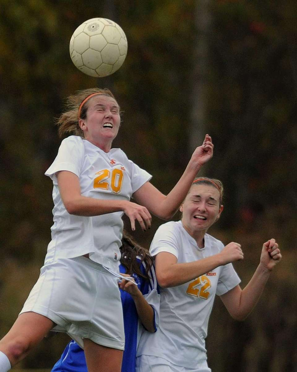 Sacred Heart Academy's Cassidy Prior, left, goes up