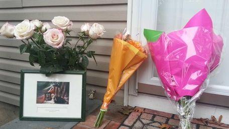 Flowers have been left outside the Babylon Village