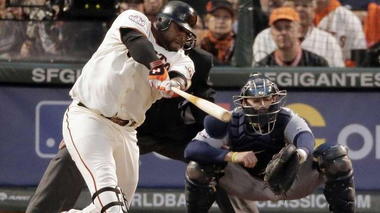 San Francisco Giants third baseman Pablo Sandoval hits