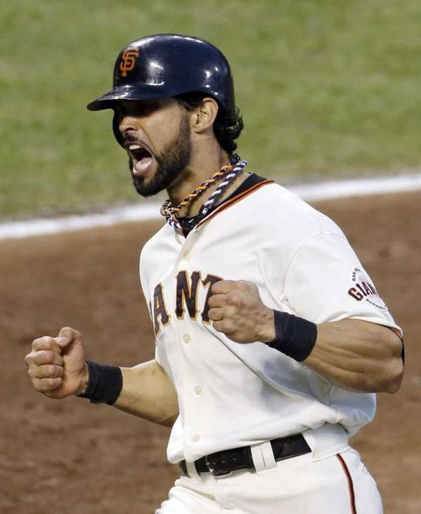 San Francisco Giants outfielder Angel Pagan reacts after