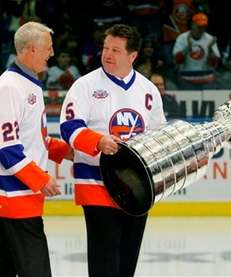Former New York Islanders Mike Bossy, left, and