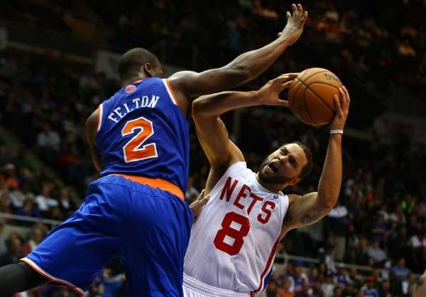 Raymond Felton defends against Deron Williams during a