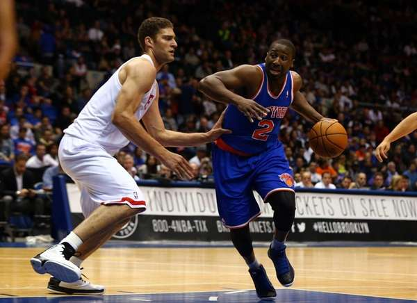 Raymond Felton drives against Brook Lopez during a