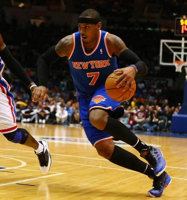 Carmelo Anthony drives to the hoop during a