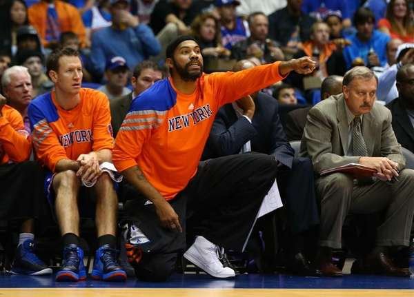 Rasheed Wallace cheers on his team as they