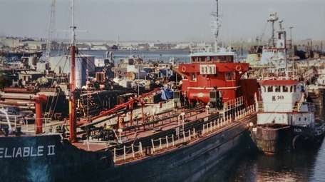 The tanker Reliable II, left, is tied up