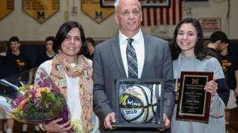 Massapequa head coach Martin Voigt is honored for
