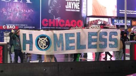 A group of NYCFC fans protests outside a