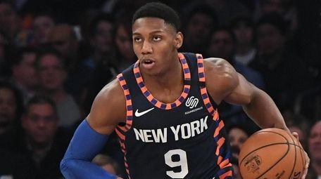Knicks guard RJ Barrett dribbles the ball up
