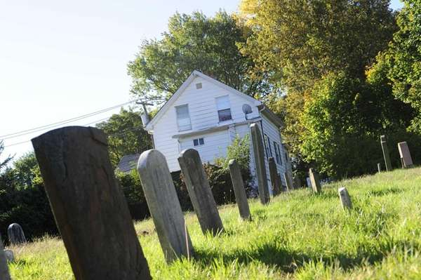 Gravestones in the historic Baptist Cemetery sit quietly