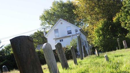 Gravestones in the historic Baptist Cemetery sit quietly