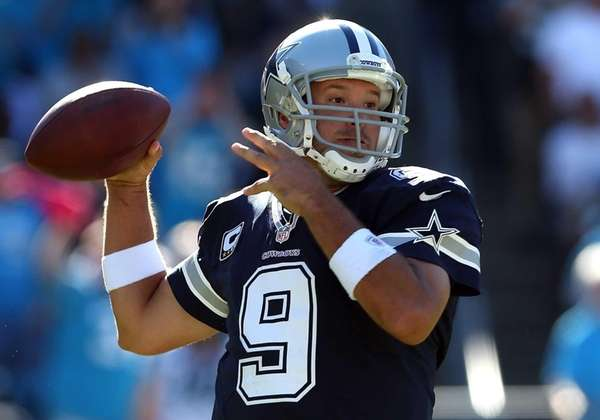 Tony Romo of the Dallas Cowboys drops back