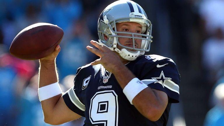 Tony Romo of the Dallas Cowboys drops back