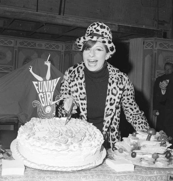 Barbra Streisand poses with birthday cake at a