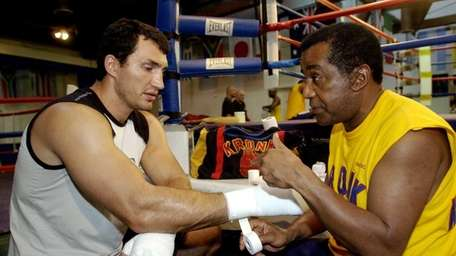 Former WBO heavyweight champion Wladimir Klitschko, left, gets