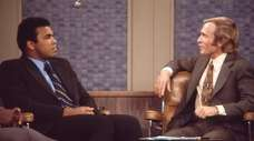 Dick Cavett, right, interviews Muhammad Ali on his
