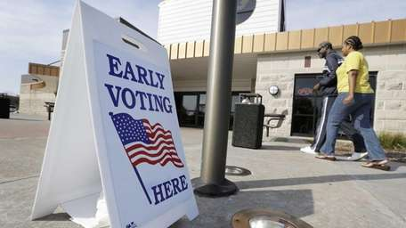 Early voters arrive at the Davenport Public Library